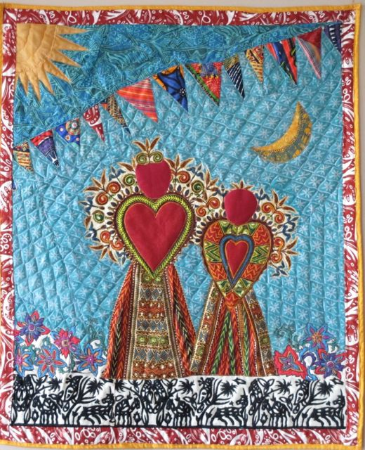 Appliqued scene of mother and daughter